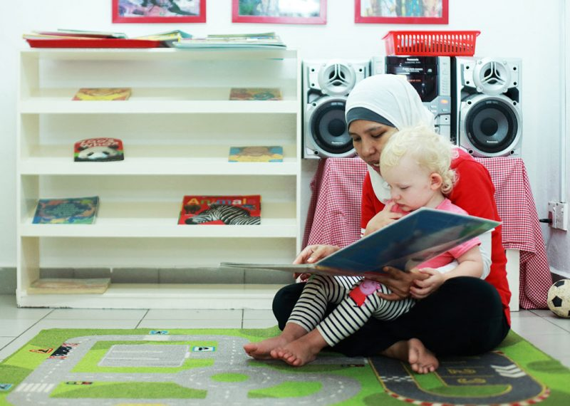TCH Aunty reads to a child