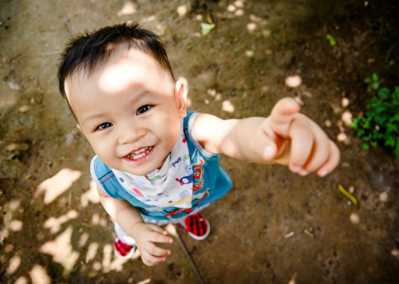 Adorable toddler looking up into the camera - Raising an Independent Decision Maker